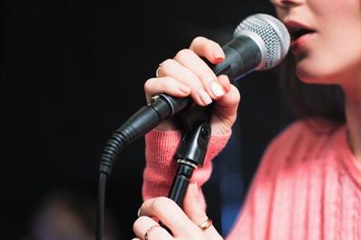 Gesangspodium Musikschule Stockfoto